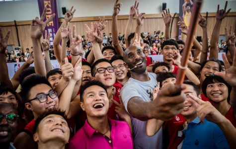 "Kobe takes a picture with some of his youth fans during the grand opening of his new ""basketball school"" in Haikou, China, during 2017."