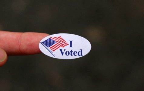 "The image captures an ""I Voted"" sticker given to Americans who vote."