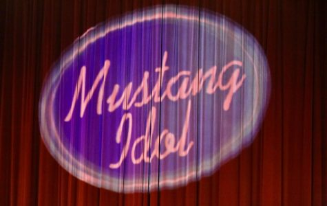 Family and friends take their seats as this custom Mustang Idol logo shines on the curtain.