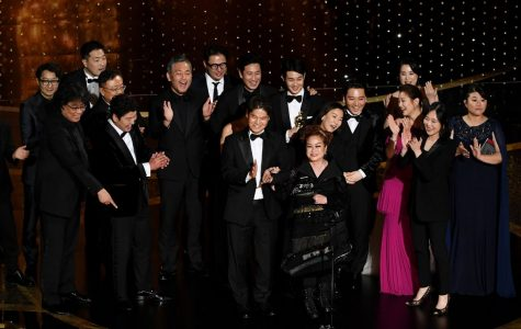 The cast of Parasite celebrates receiving Best Picture on stage at the 2020 Academy Awards.