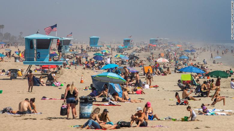 People enjoy the beach on April 25, 2020 amidst the nationwide coronavirus outbreak