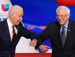 The remaining democratic candidates, Bernie Sanders and Joe Biden on stage during the break of their debate joking about their matching suit colors.