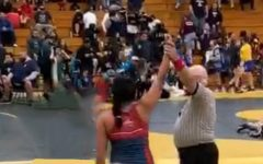 The end of a wrestling match won by Karina Shah.