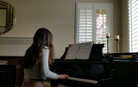 Juliana Person (9) plays a piano piece for her church's live stream April 19, 2020
