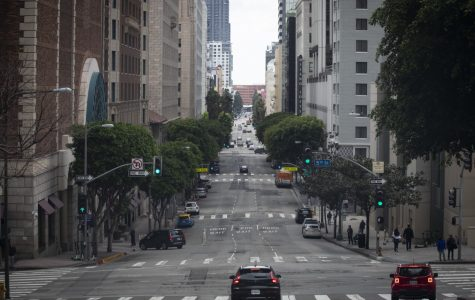 Downtown Los Angeles' usually bustling Grand Avenue sees light traffic during the lockdown.
