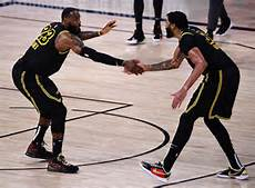 LeBron James and Anthony Davis displaying their friendship on the court as they win the second game against the  Houston Rockets during the second round of the playoffs.