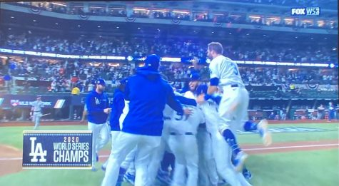 The Los Angeles Dodgers celebrate on the field as they win the Major League Baseball World Series.