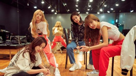 All four members of Blackpink pose here in the dance studio they trained in for four years as trainees prior to their debut in 2016.