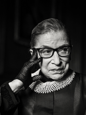 Ruth Bader Ginsberg posing for the camera in her signature Supreme Court collar.