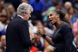Serena Williams showing her passion for her sport as she talk to US Open official.