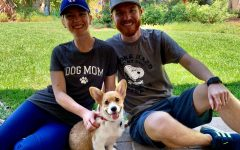 Mr. Hipwell and his wife posing with their new dog, Thor, that they got over quarantine.