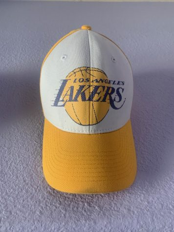A vintage Los Angeles Lakers hat on display as a decoration.
