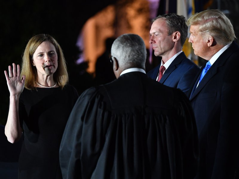 Amy Coney Barrett being sworn in as a US Supreme Court Associate Justice at the White House in Washington, DC.
