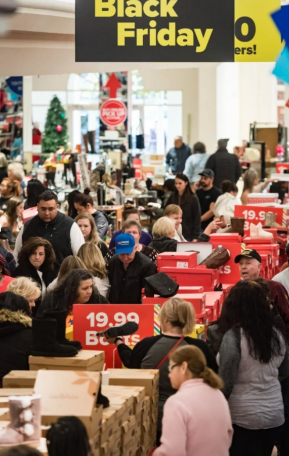 Black Friday shoppers line the isles in recent sale years.