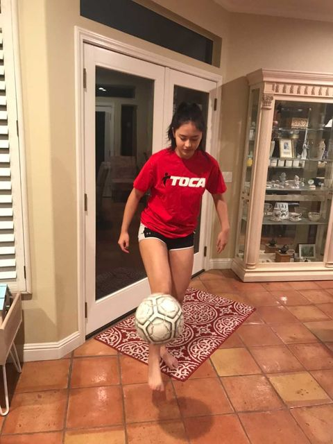 An example of Hannah Bucklin (11) playing soccer at home to continue with her soccer fitness.