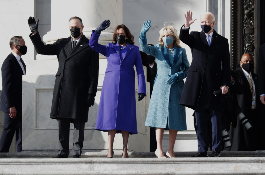 With+both+of+their+partners+beside+them%2C+newly+confirmed+Vice+President+Kamala+Harris+and+President+Joe+Biden+wave+to+the+American+people+as+they+begin+their+new+terms.+