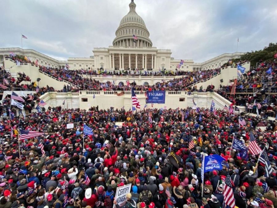 On+Wednesday%2C+January+6%2C+thousands+of+Trump-supporters+surrounded+the+Capitol+building%2C+with+scores+of+people+forcefully+entering+the+building.+Shattered+glass+surrounded+the+area+and+confrontation+between+police+and+protesters+arose.+
