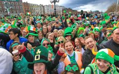 People gathering together to celebrate St. Patrick's Day.