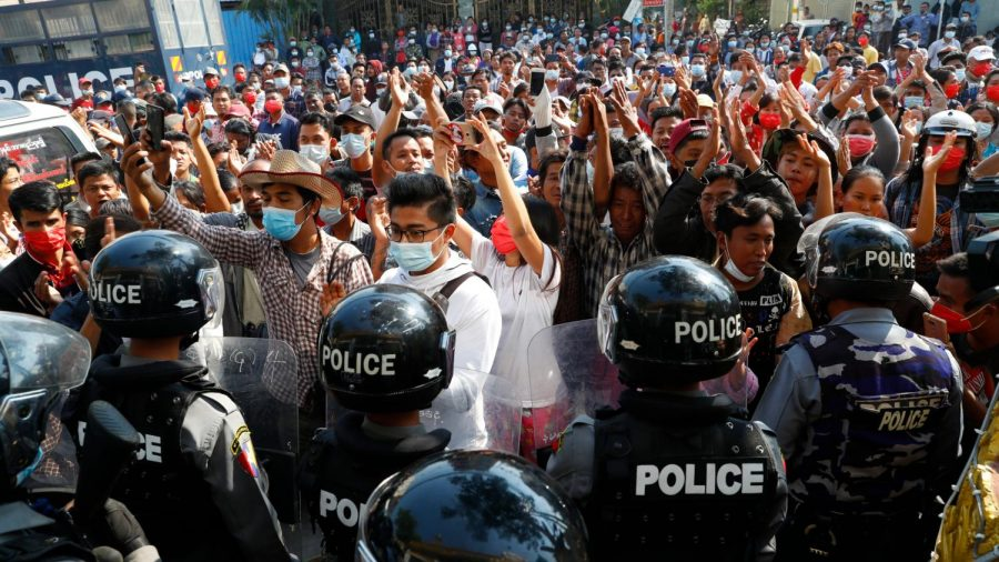 People+in+Myanmar+participate+in+a+deadly+protest+against+a+military+coup.