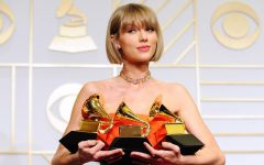 """Taylor Swift posing with her three Grammy's back in 2016 for her fifth studio album, 1989, making her one of two female artists who have won """"Album of the Year"""" twice."""