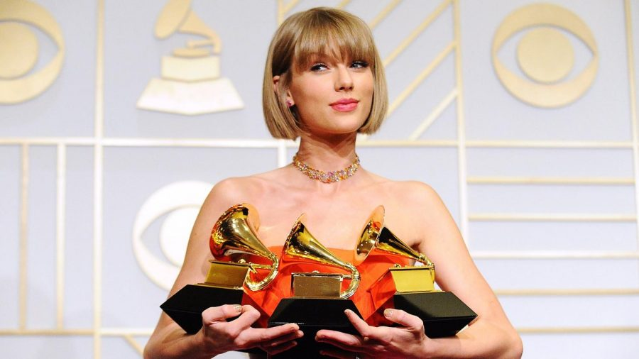 "Taylor Swift posing with her three Grammy's back in 2016 for her fifth studio album, 1989, making her one of two female artists who have won ""Album of the Year"" twice."