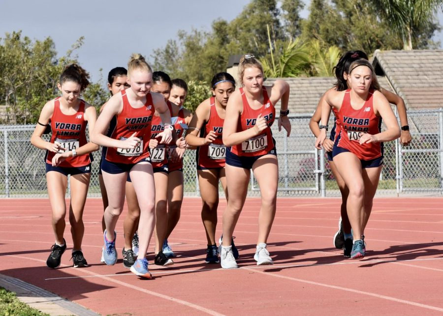 The+girls+from+the+Cross+Country+team+compete+in+the+end+of+February+during+their+first+meet+since+the+Fall+of+2019.