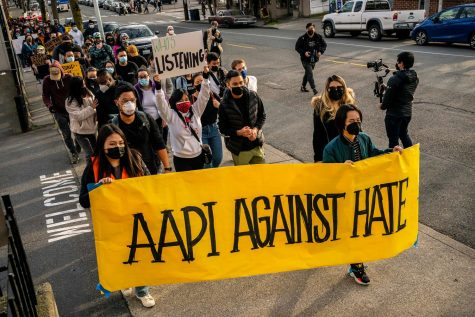 Protestors march together to fight against hate towards the AAPI community.
