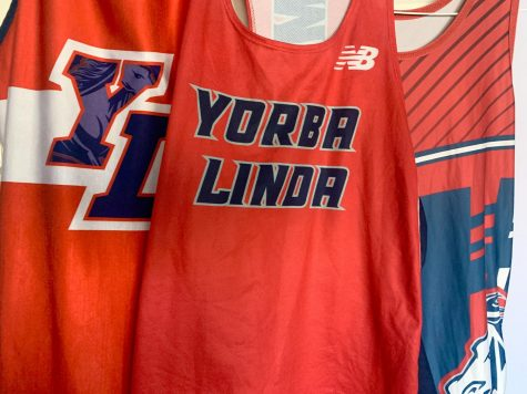 A few Yorba Linda High School uniforms from the YL Wrestling team and Track team.