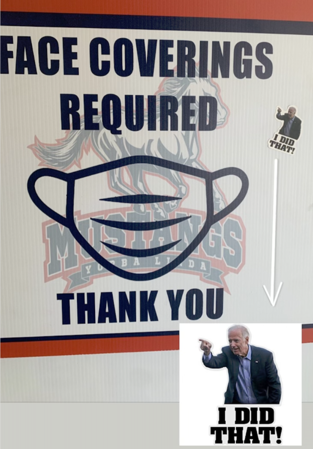A+sticker+of+Joe+Biden+with+the+caption+%E2%80%9CI+DID+THAT%21%E2%80%9D+pointing+at+a+sign+that+demonstrates+the+mask+requirement+indoors+at+YLHS.+