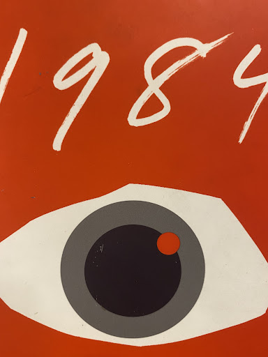 The cover of 1984, which illustrates an all seeing eye that makes sure everyone agrees with the government's ideologies.