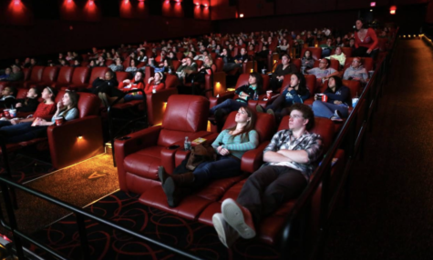 A full theater of viewers gather to watch a movie pre-covid.