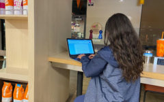 The college application essay is an extremely difficult part of the college application process. Alexandra Herrada (11) is helping her friends refine their essays.